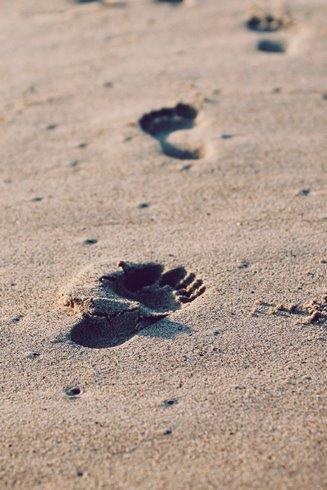 Footprints in sand - photo by Christopher Sardegna on Unsplash