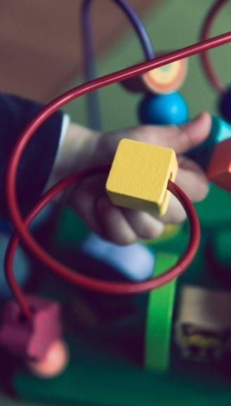 Children's toy with blocks to move on twisted wire arrangement - photo by Markus Spiske on Unsplash